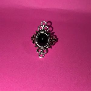 Brand new silver costume ring with black jewl